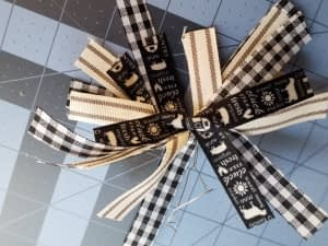easy bow using dollar tree ribbon and a little bit of wire