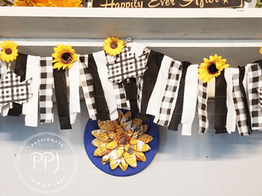 diy simple leaf banner using buffalo checks, wooden maple leaves, and sunflowers