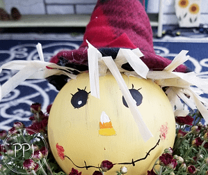 create a pumpkin and scarecrow tealight using simple objects