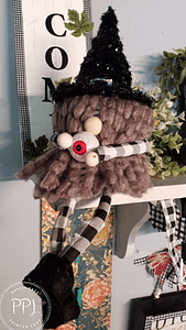 cute toilet paper gnome with buffalo check material and yarn