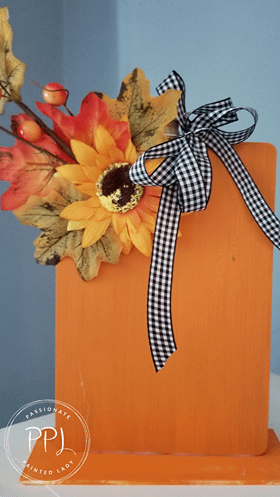 create a cute wooden pumpkin sitter using cutting boards and easy-to-find supplies