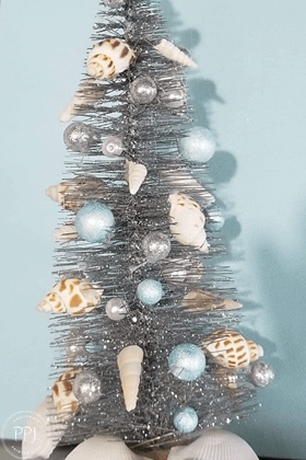 coastal christmas tree created using cheap and affordable seashells and ocean creatures